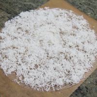 Step 8 - Use parchment paper to collect dried coconut