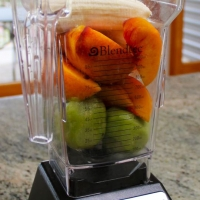 Step 1 - Add kiwi, peaches, and bananas to blender