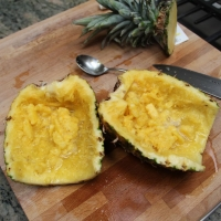 Step 3 -  Cut pineapple in half and gently scrape out flesh from insides