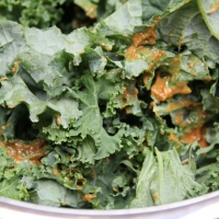 Step 3 - In a large bowl, pour mixture over kale
