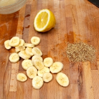 Step 2 - Dip banana pieces into lemon juice and roll in chopped pecans